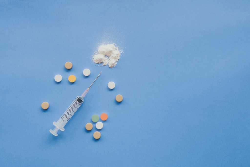 top view of syringe with pills